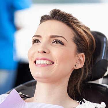 Woman smiling during oral cancer screening