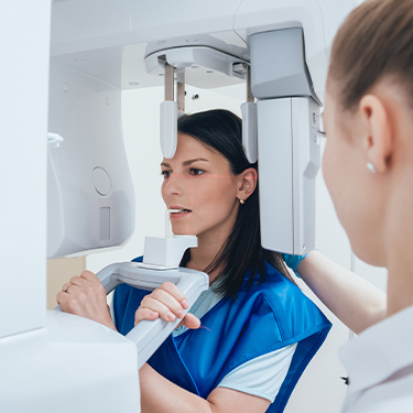 Woman receiving 3 D C T Cone beam dental x-ray