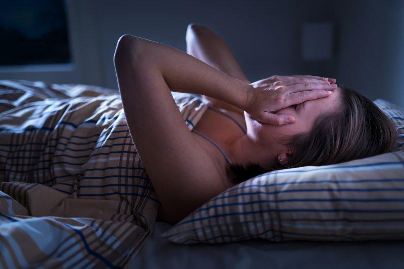Woman struggling to fall asleep