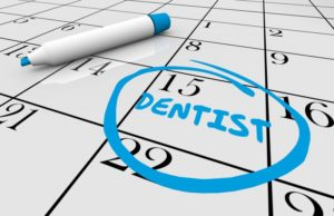 date of dental checkup circled on calendar