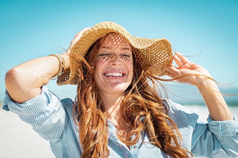 woman smiling on the beach during summer