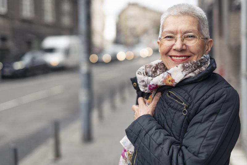 Woman smiling with dental implants